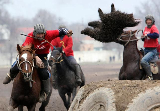 a game of polo with a headless goat Dead goat polo: sophie ibbotson goes to the village of ashu in kyrgyzstan to  watch a game of kok boru, dead goat polo, the national sport of kyrgyzstan.